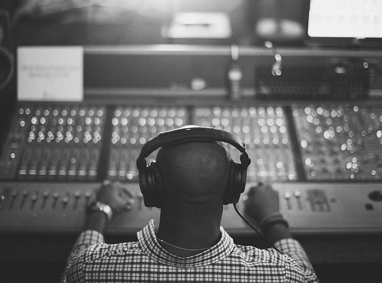 Man mixing on sound board